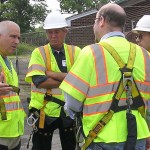 Shawn Padgett discusses peregrine removal with bridge workers