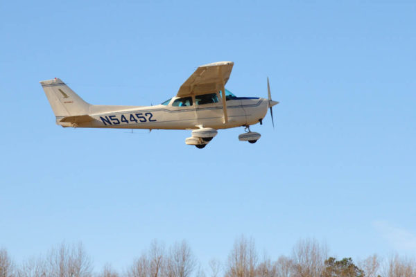 Survey crew in March flying over the shoreline of the James River. Photo by Bart Paxton.