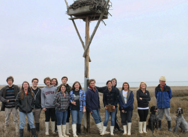 A school group from Cape May Tech pictured with an osprey nest they adopted for OspreyWatch near Cape May, NJ. Cape May Tech's students erected this nest, and it is monitored by Natural Sciences Class students in partnership with NJ Fish & Wildlife and Conserve Wildlife Foundation of NJ.