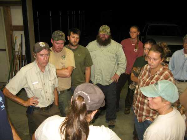 Woodpecker crew gathers around Kelly Morris around 2:30 AM to receive field assignments for placement of woodpeckers. Photo by Bryan Watts.